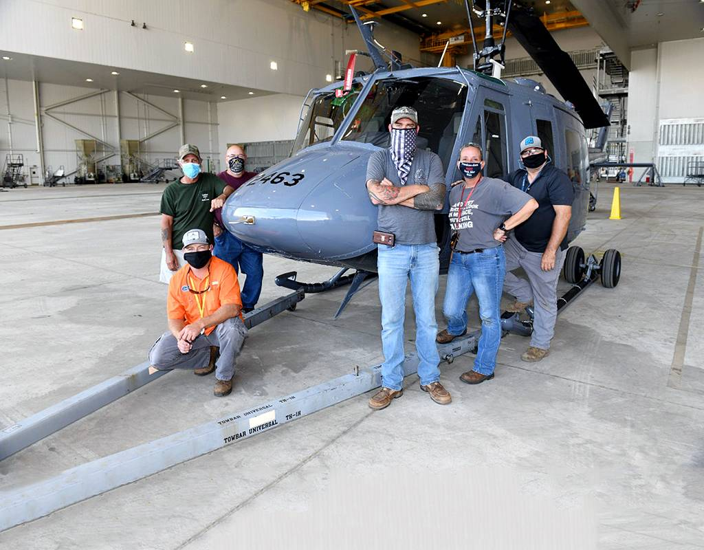 The 563rd Maintenance Squadron maintenance team with the Warner Robins Air Logistic Complex stands with a TH-1H trainer helicopter at Robins Air Force Base, Georgia. TH-1H programmed depot maintenance is proof-of-concept first at WR-ALC and will determine the feasibility of utilizing the complex as a viable source of repair for future organic rotary wing aircraft maintenance. U.S. Air Force Photo by Joseph Mather