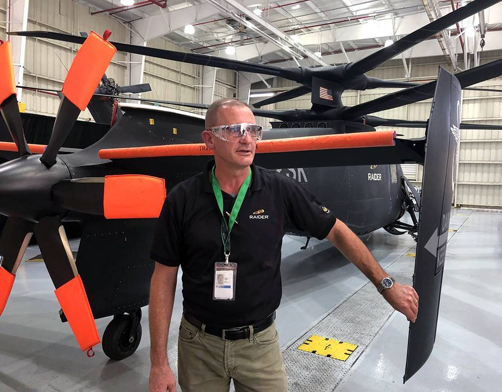 Sikorsky chief test pilot Bill Fell at the tail end of the S-97 Raider at Sikorsky's test flight facility in West Palm Beach, Florida. Dan Parsons Photo