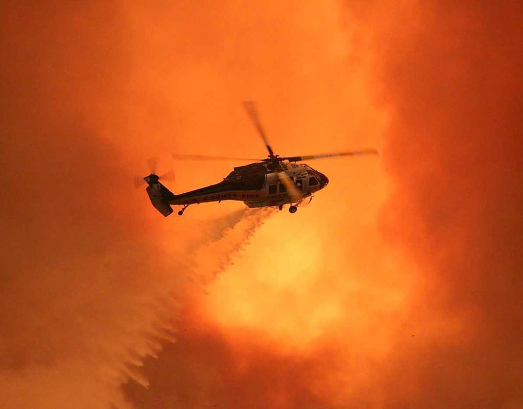 Fire crews were still battling enormous blazes at the end of August, and are preparing themselves for a long period of firefighting into the fall. Greg Doyle Photo