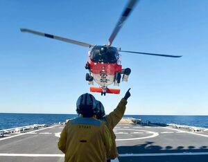 Crewmembers of the U.S. Coast Guard Cutter Stone (WMSL 758) guide an MH-60 Jayhawk helicopter to land on the Stone's flight deck off the coast of Florida on Dec. 27, 2020. USCG Photo by Petty Officer 3rd Class John Hightower