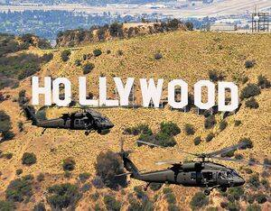 A pair of UH-60M Black Hawks cruise by the iconic Hollywood sign in the hills overlooking Los Angeles. Skip Robinson Photo