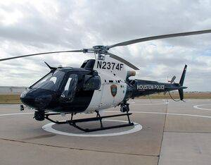 The blue line on the Houston Police Department's new helicopter is the same color blue that Officer Knox used to restore old police vehicles. Houston Police Department Photo