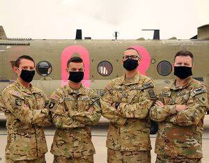CH-47 Chinook Crew: (from left) CW2 Brady Hlbain, SGT Cameron Powell, SGT George Esquivel, and CW5 Joesph Rosamond. HAI Photo