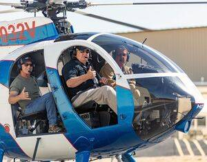 Veteran pilot Hugh Mills, Jr., takes a quick spin in an MD 500 with MDHI Senior Flight Instructor Dave Salem and Cinematography Pilot/Reporter Bruce Haffner. MDHI Photo