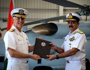 Vice Adm. Kenneth Whitesell, Commander, U.S. Naval Air Forces, left, presents the Material Inspection and Receiving Report for first aircraft to Vice Adm. Ravneet Singh, Indian Navy Deputy Chief of Naval Staff, during an acceptance ceremony at Naval Air Station North Island on Friday, July 16. MC2(SW/AW) Sara Eshleman for U.S. Navy Photo