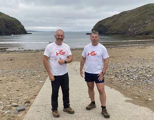 Steve Landrey, (left) with his cardiac rehabilitation instructor David Braithwaite. WAAC Photo