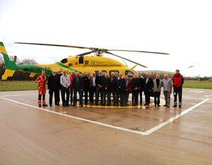 Former Air Support Unit crew stand by Wiltshire Air Ambulance's Bell 429 helicopter with current paramedic Craig Wilkins (far left), pilot Rob Collingwood (far right) and Kevin Reed, head of facilities and security (fourth from left). Wiltshire Air Ambulance Photo