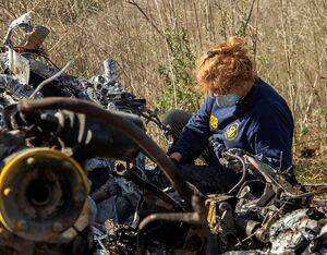 NTSB investigator Carol Horgan examines the wreckage of the Sikorsky S-76B that crashed near Calabasas, California, on Jan. 26, killing nine people including Kobe Bryant. NTSB/James Anderson Photo