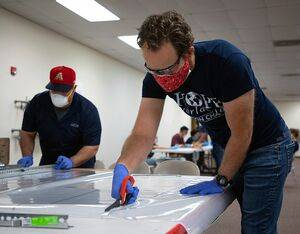 Universal Avionics is providing assembly line space at its Tucson headquarters to the non-profit group Hope Worldwide (Tucson Chapter) to manufacture medical face masks and shields. Universal Avionics Photo