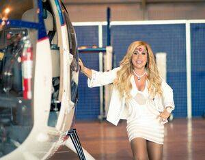 A 2015 photo of Lynn Tilton at the MDHI facilities in Mesa, Arizona. Famous in the helicopter industry for her theatrical Heli-Expo press conferences, Tilton was never one to shy away from attention. Patriarch Partners Photo