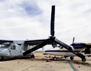 The parked MV-22B Osprey that was impacted by an occupied Twin Otter aircraft had damage to its left wing, engine and propeller blade. City of San Diego Photo