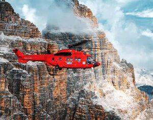 This stunning photo of a Heli Austria Firecat flying past Italy's Tre Cime di Lavaredo is a finalist for the 2020 Aerospace Media Awards' Best Aviation Image. Lloyd Horgan Photo