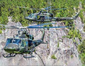 The CH-146 Griffons are equipped with standard protection such as the C6, GAU 21 or Dillon M134 machine guns.. Mike Reyno Photo