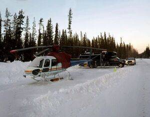 An RCMP AS350 B3 helicopter made a forced landing on a roadway after it collided with an RCMP-operated surveillance drone. Both the helicopter and the drone were damaged. Clayton Little/Global News Photo