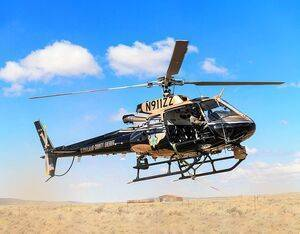 A Bernalillo County Sheriff's Department Airbus AS350 B3 rescued a man from the bottom of Rio Grande Gorge using a 150-foot short haul line. Taylor Gwinn Photo