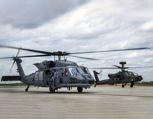 An HH-60W Jolly Green II taxies in followed by an AH-64 Apache on May 19 at Eglin Air Force Base, Florida. U.S. Air Force/Samuel King Jr. Photo