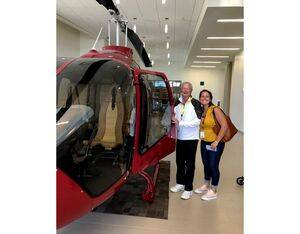 Bell's Emma Spencer with her grandfather alongside a Bell 505 Jet Ranger X. Bell Photo